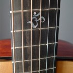 Om symbol inlay on the handmade Dream Series Baritone Guitar
