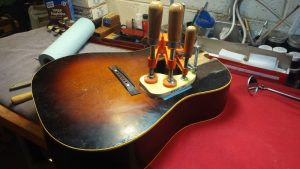 gluing on a replacement pickguard on a Gibson J45